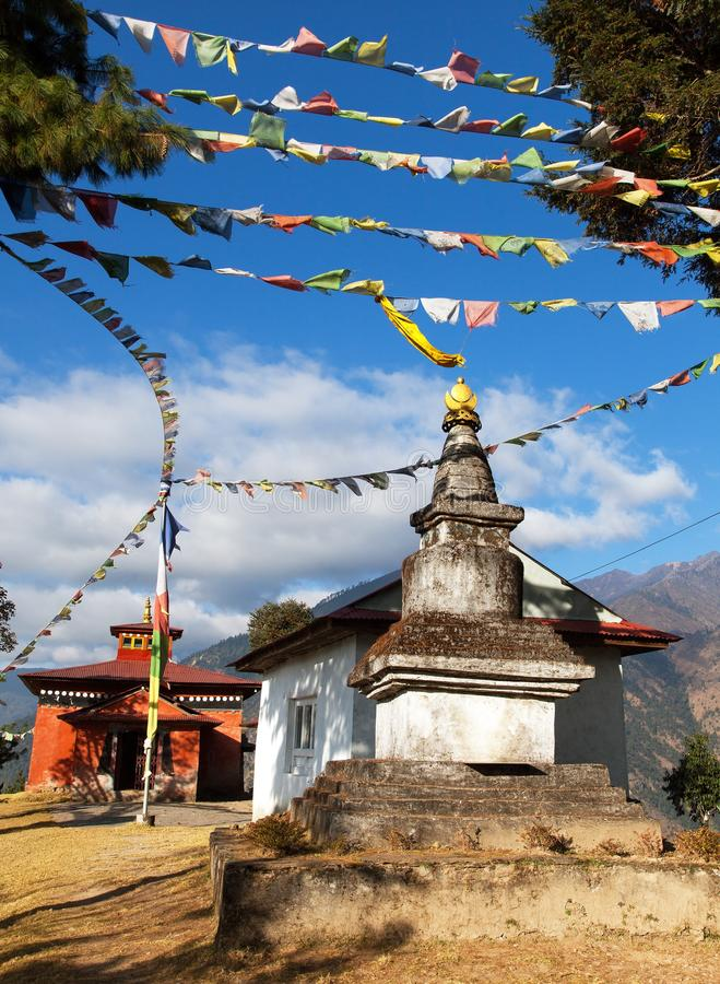 Bupsa gompa monastery and stupa with prayer flags stock images