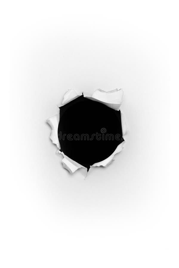 Buraco de bala através do papel fotografia de stock royalty free