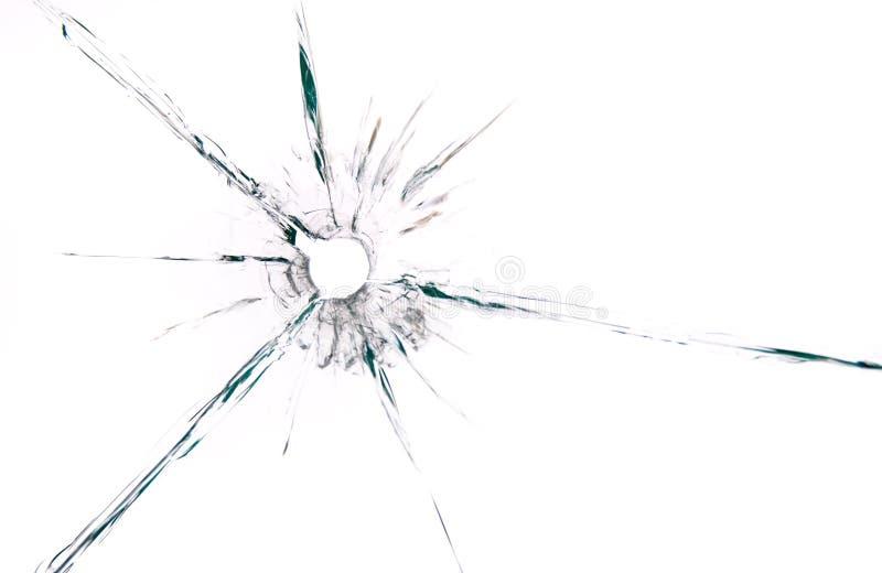 Buraco de bala no fim do vidro acima no fundo branco imagens de stock