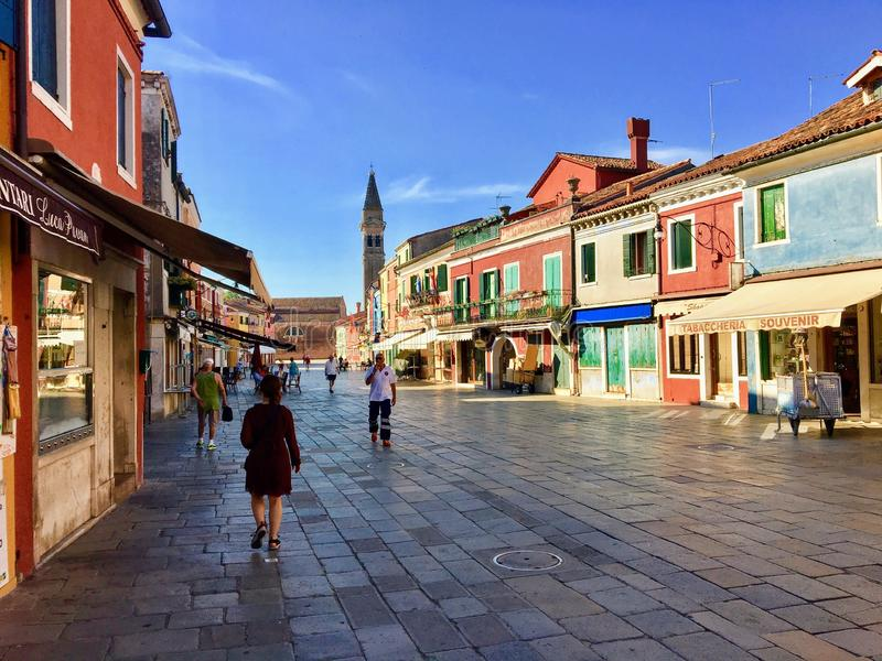 A view of the quiet town square of Burano, Italy during the early morning. stock photos