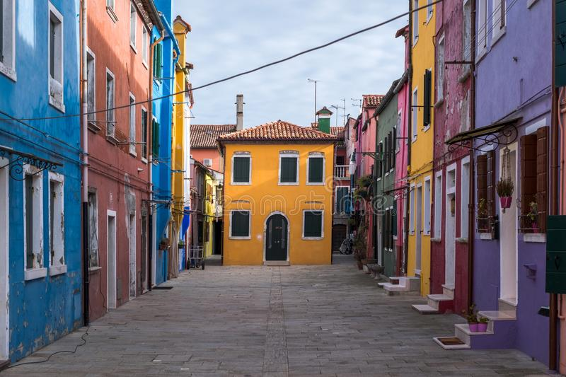 Street of brightly coloured houses on the island of Burano, Venice. Photograph taken on a sunny day. stock images