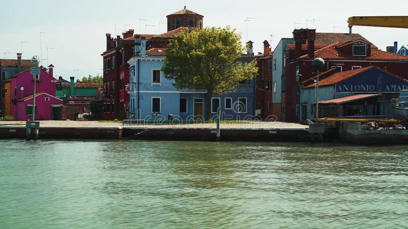 BURANO - JULY 14: Real time establishing shot from the water of a colorful houses on the island of Burano. Burano island royalty free stock images