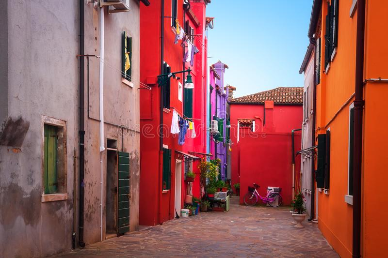 Burano street, Venice, Italy. Painted colorful houses in Burano island stock photos