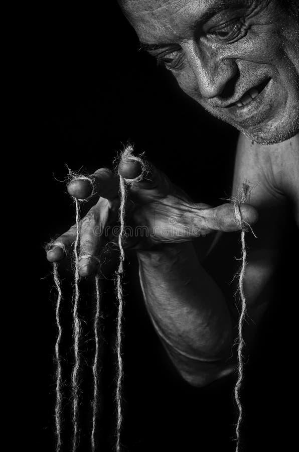 Burattinaio pazzo in bianco e nero fotografie stock