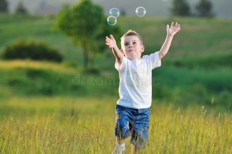Burbuja del niño imagenes de archivo