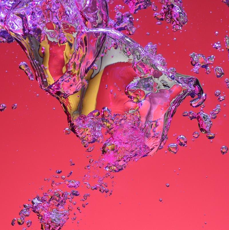 Burbujas de aire coloridas en agua fotografía de archivo