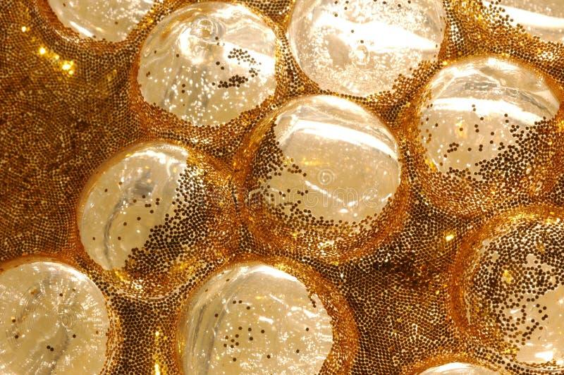 Burbujas de cristal de oro foto de archivo libre de regalías