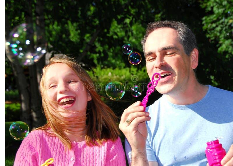 Burbujas de la familia imagenes de archivo