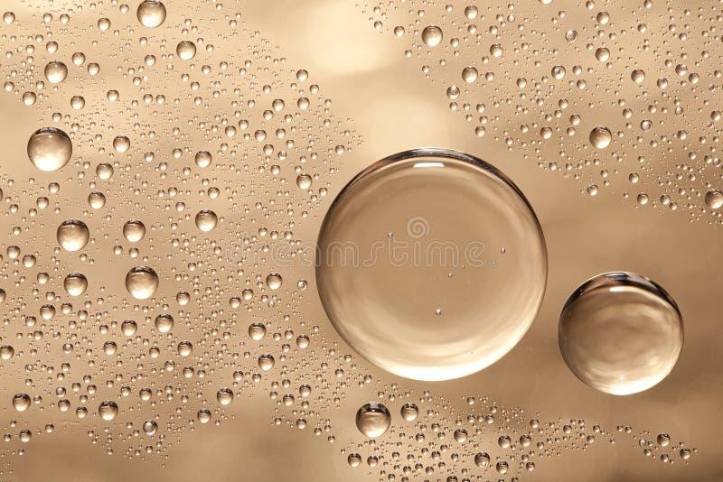 Burbujas del agua sobre el vidrio foto de archivo libre de regalías