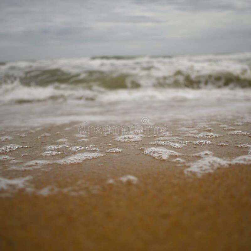 Burbujas en la playa fotografía de archivo