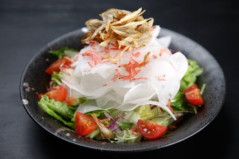 Burdock root and radish salad stock images