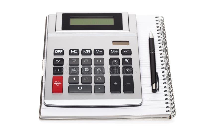 Bureauboek met een potlood en een calculator stock afbeeldingen