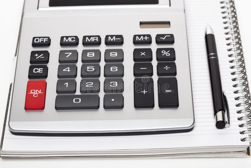 Bureauboek met een potlood en een calculator royalty-vrije stock afbeeldingen