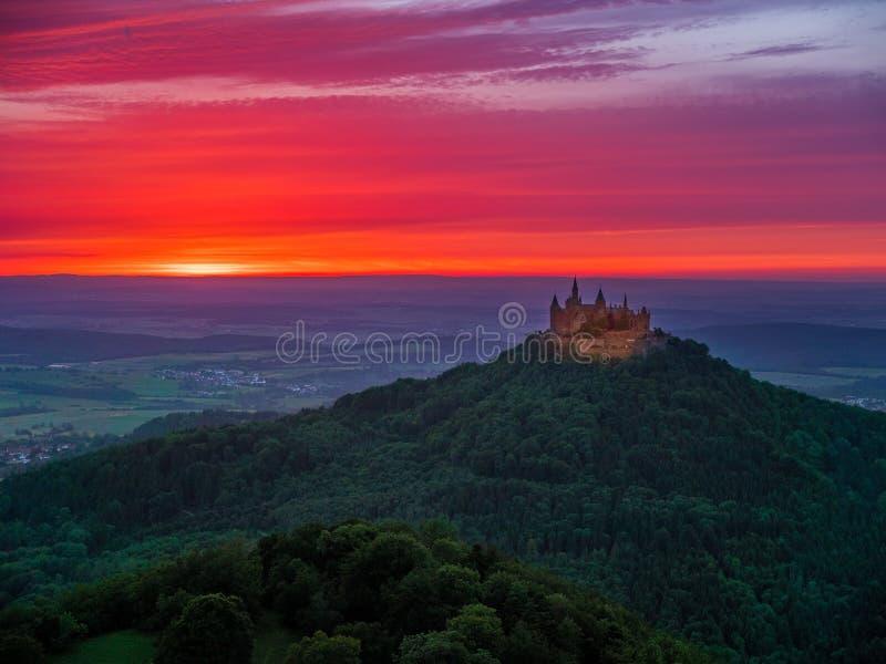 Burg Hohenzollern Castle. Evening mood with sunset near Burg Hohenzollern Castle, Swabian Alb, Baden-Wuerttemberg, Germany, Europe royalty free stock image