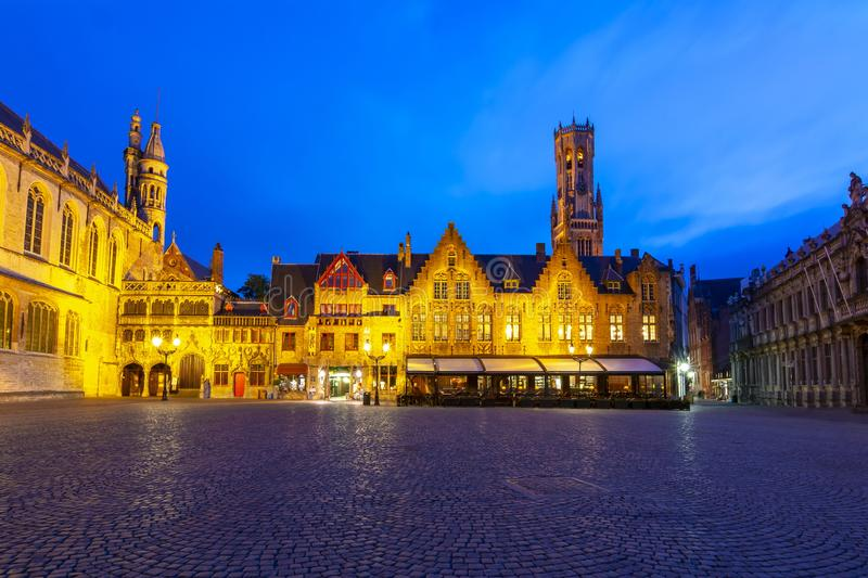 Burg square with Basilica of the Holy Blood and Belfort tower at background at night, Bruges, Belgium stock image