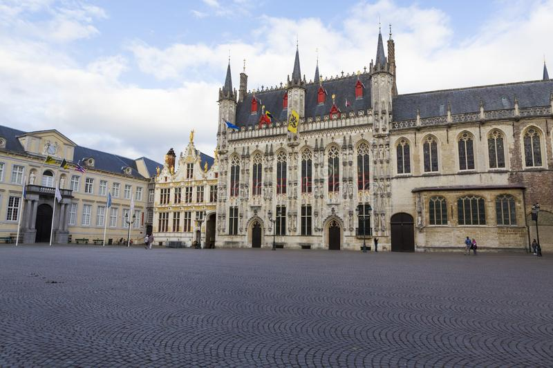 The Burg Square and the City Hall from Bruges city. Tourist visiting The Burg Square and the City Hall from Bruges city in Belgium stock image