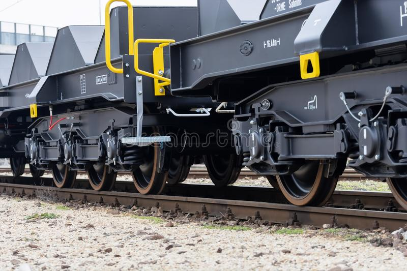 Burgas, Bulgaria - January 24, 2017. Freight cargo train - black cars wagons. New 6-axled flat wagon ,Type: Sahmmn, Model WW 6. 04 A, Transvagon AD royalty free stock images