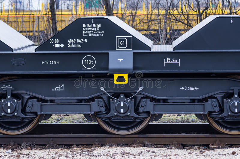 Burgas, Bulgaria - January 24, 2017 - Freight cargo train - black cars wagons - New 6-axled flat wagon - Type: Sahmmn - Model WW 6 royalty free stock image