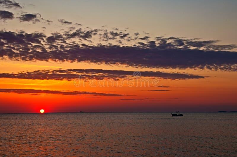 Burgas coastal. Sunrise with boat in Burgas coastal stock photography