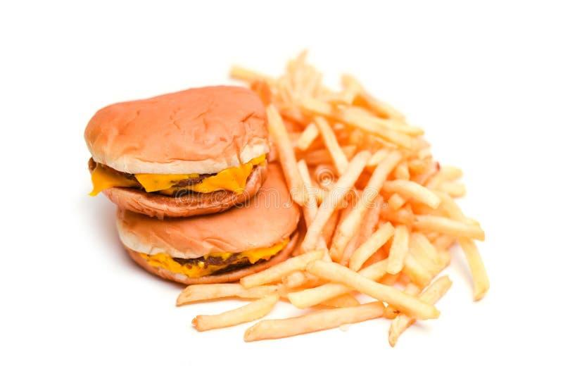 Burger και τηγανιτές πατάτες γρήγορου φαγητού που απομονώνονται στο λευκό στοκ εικόνες