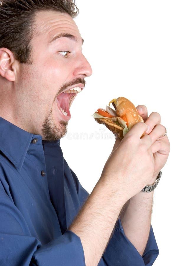 burger που τρώει το άτομο στοκ φωτογραφία με δικαίωμα ελεύθερης χρήσης