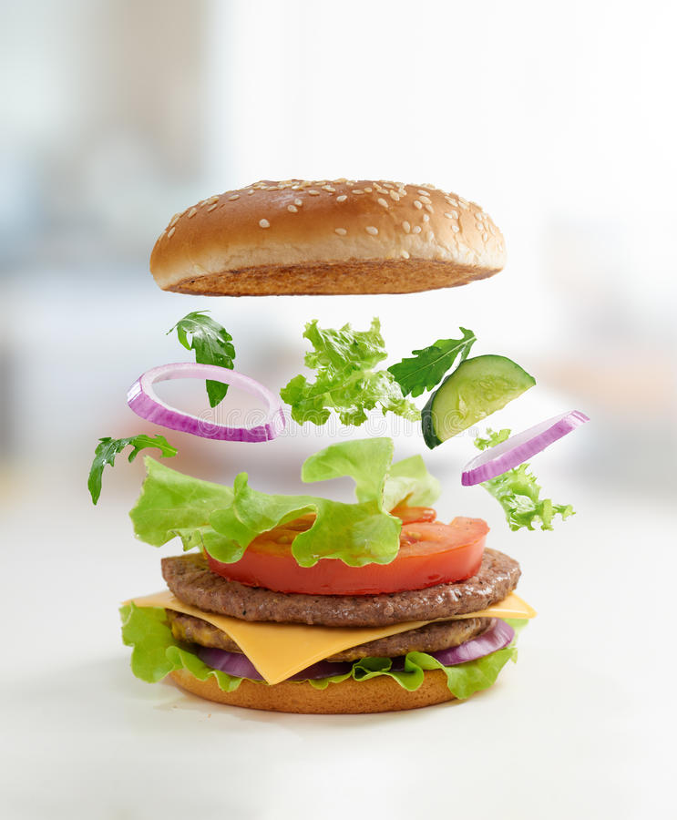 Burger. Tasty big burger close up royalty free stock image