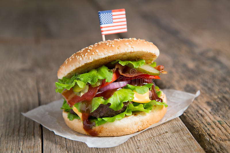 Burger with beef, onion, cheese, barbecue sauce. American burger with beef, onion, cheese and barbecue sauce stock image