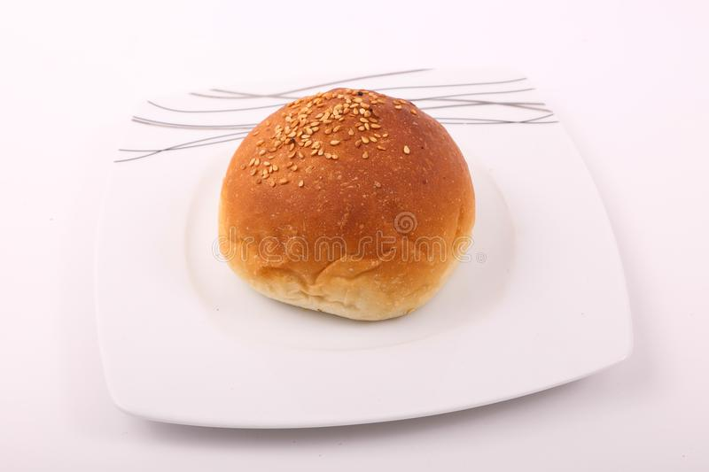 Burger Bread on white dish. Variety of bakery on white background stock photos