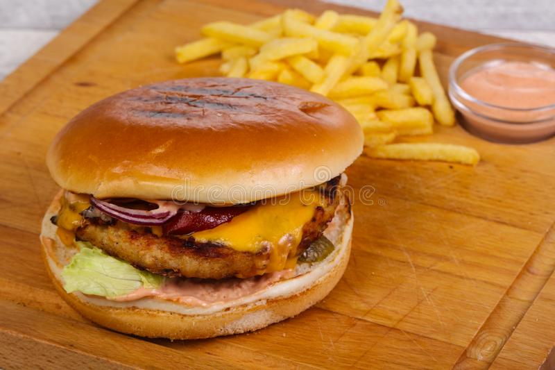 Burger with chicken, cheese and red onion. Burger with chicken, cheese, pepper, cucumbers and red onion stock photos