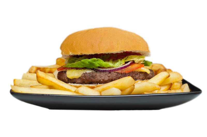 Burger and chips on a plate royalty free stock images
