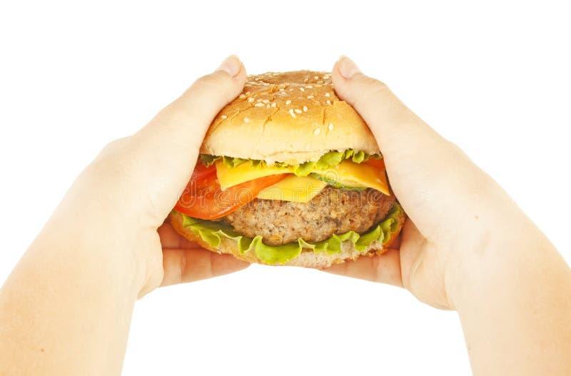 Burger in den Händen lizenzfreies stockfoto