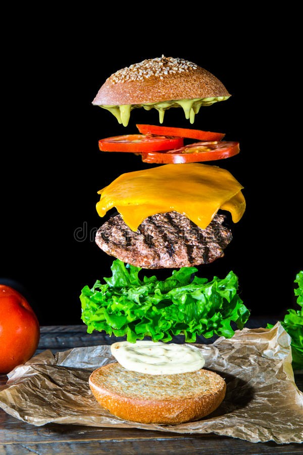 Burger disassembled in layers. stock images