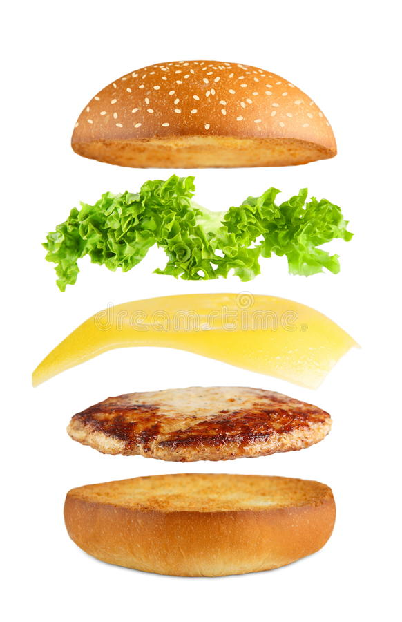 Burger explosion, flying layers isolated. American food. Burger layers isolated. Separated burger layers isolated. Hamburger exposion. Cheeseburger flying royalty free stock photo