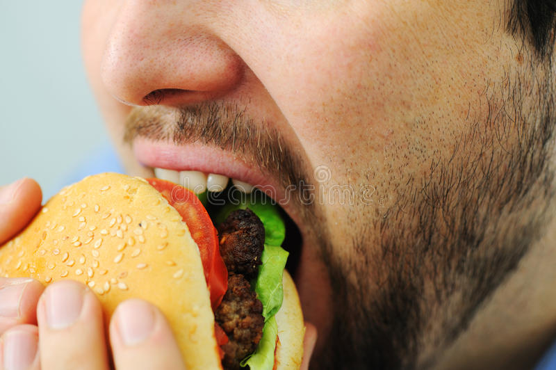 Burger, fast food. Burger on mouth , fast food stock image