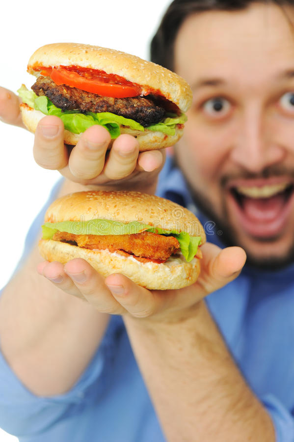 Burger, fast food. Happy man royalty free stock photo
