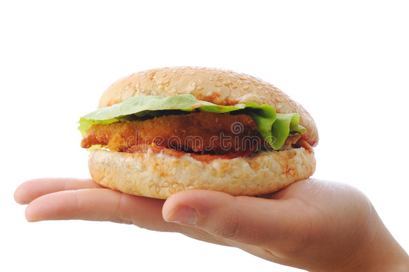 Burger, fast food. On hand royalty free stock photo