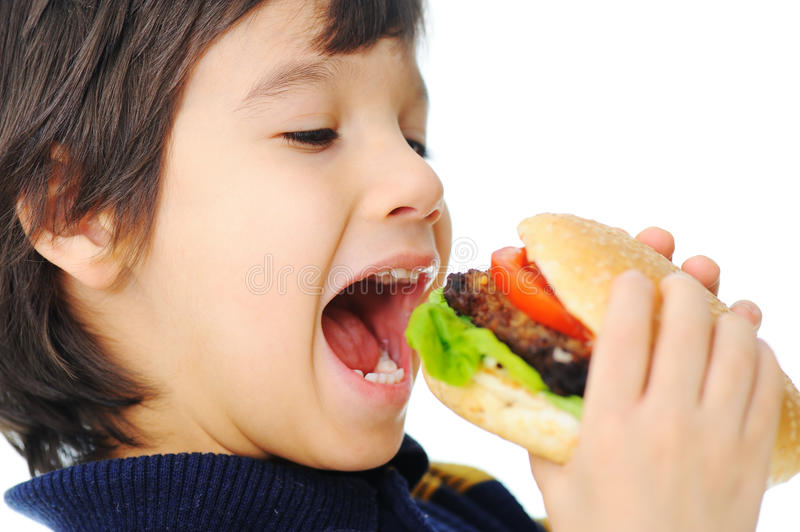 Burger, fast food. Hungry boy stock photo