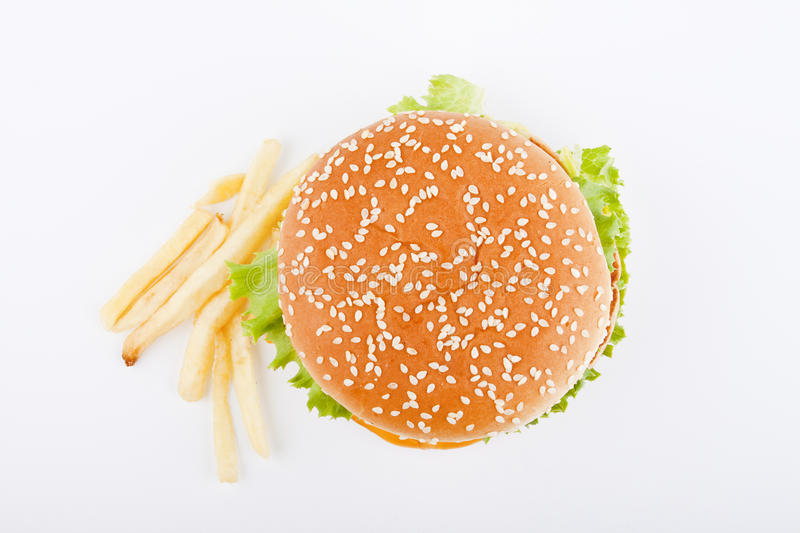 Burger and french fries. Isolated on white top view stock photo