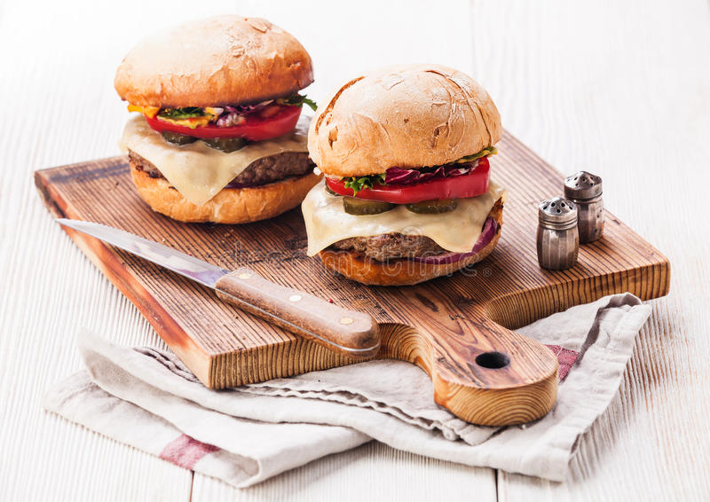 Burger with meat on cutting board stock photos