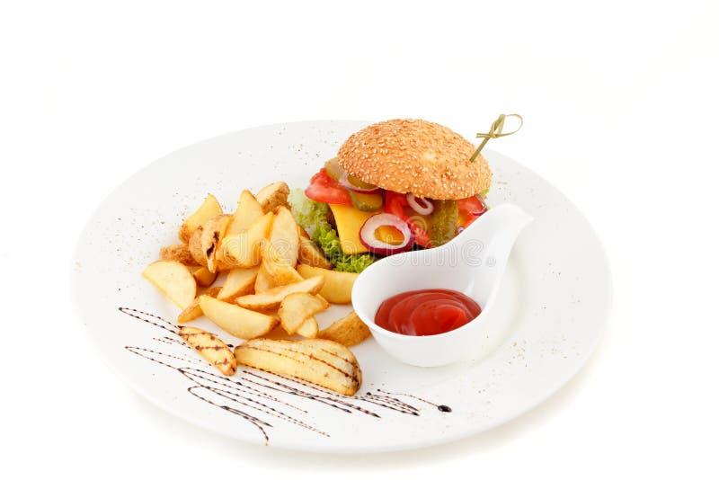 Burger with potato and ketchup stock photos
