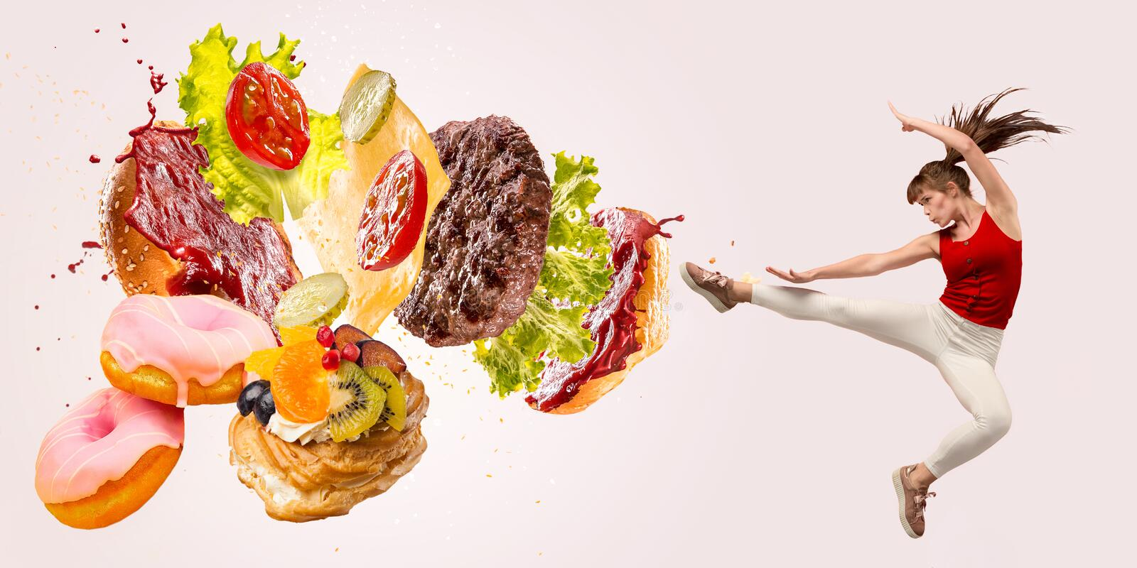 Burger`s crashing by the boxer isolated on white background. Fight the fast food. Burger`s crashing by the boxer isolated on white background. Combination of royalty free stock photos