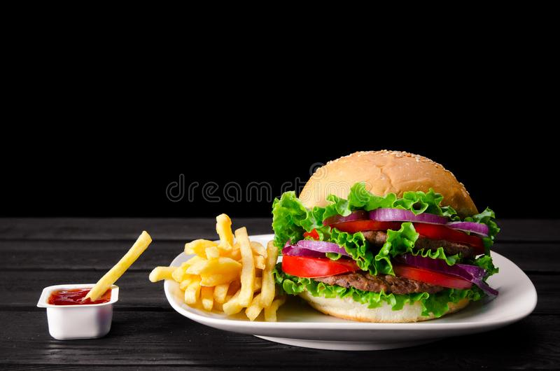 The burger served in bun in nutrition fast food concept. Burger served in bun in nutrition fast food concept stock images