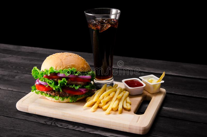 The burger served in bun in nutrition fast food concept. Burger served in bun in nutrition fast food concept royalty free stock image