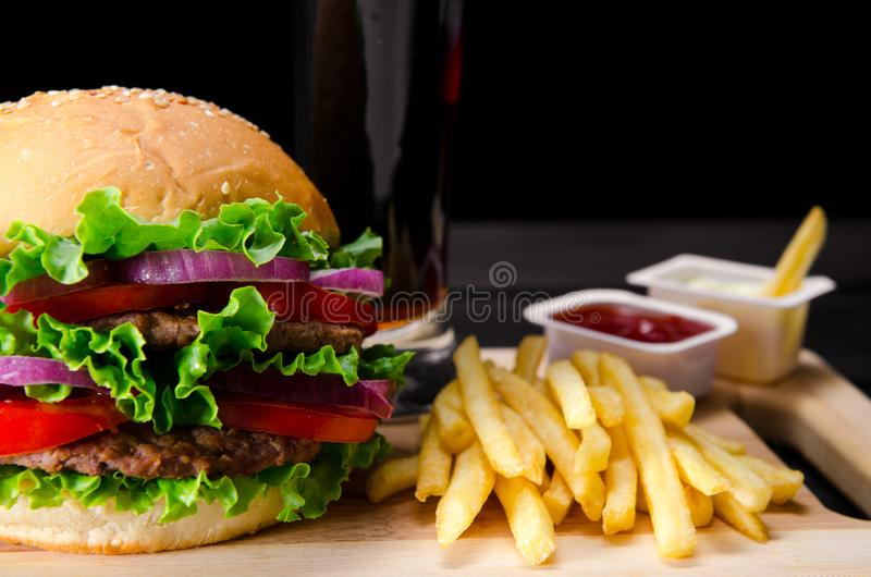 The burger served in bun in nutrition fast food concept. Burger served in bun in nutrition fast food concept royalty free stock photography