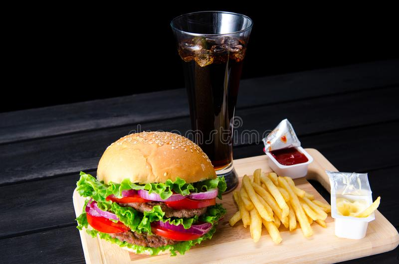 The burger served in bun in nutrition fast food concept. Burger served in bun in nutrition fast food concept royalty free stock photos