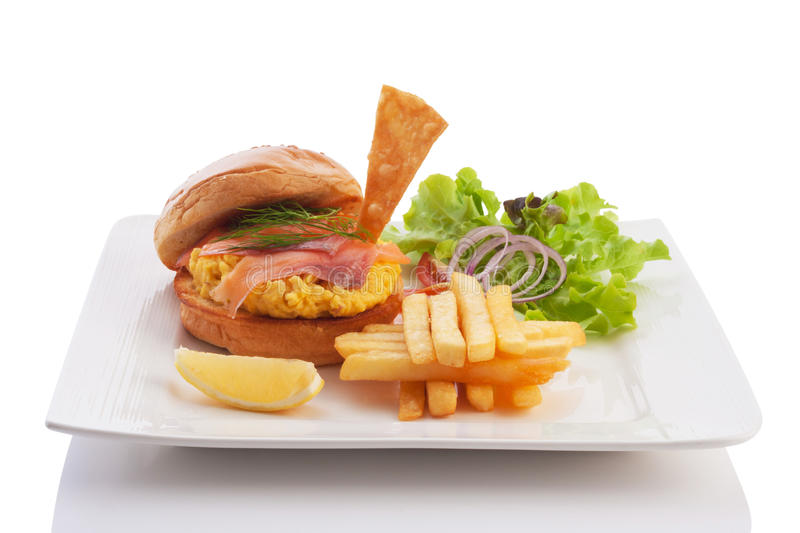 Burger with smoked salmon and egg royalty free stock photography