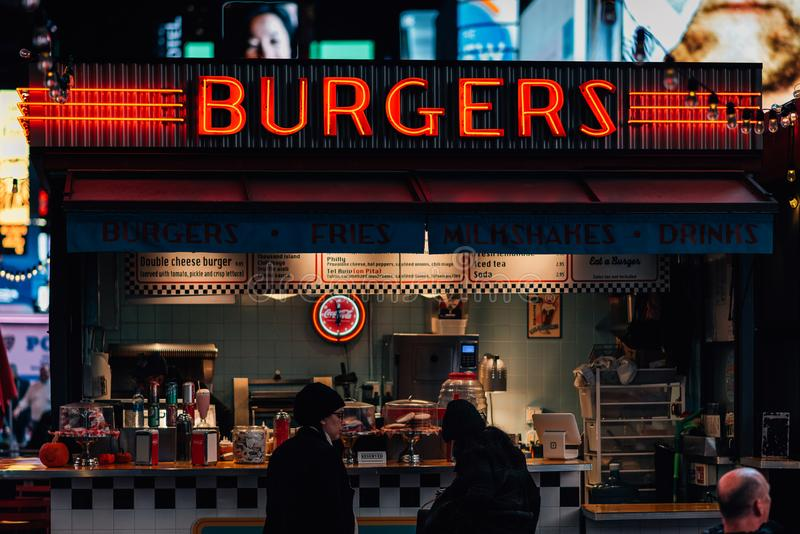 Burger Stand at Times Square, in Midtown Manhattan, New York City royalty free stock photography