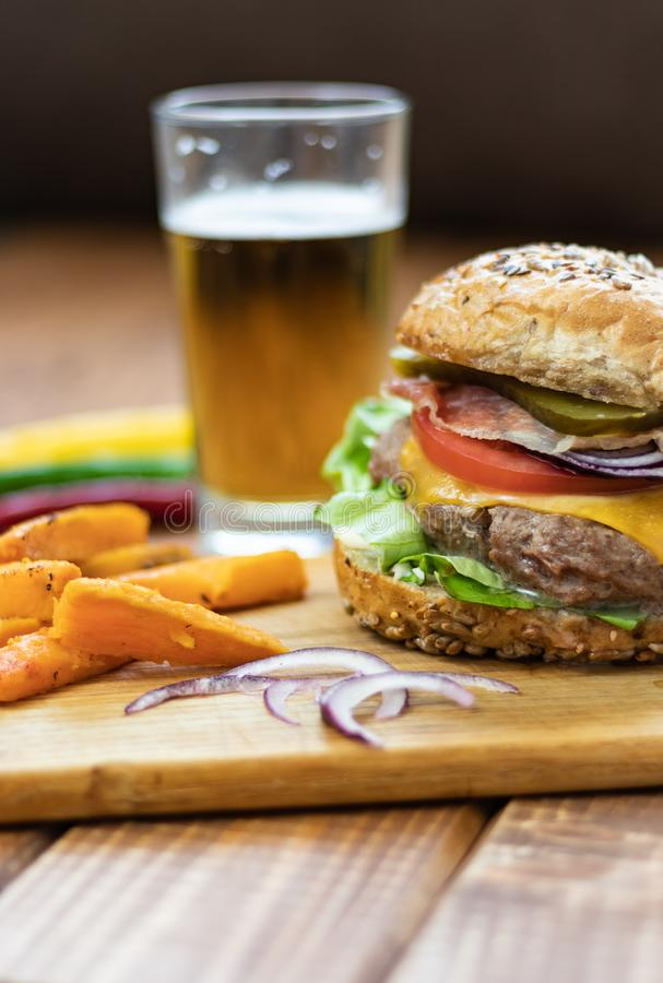 Burger with sweet potato fries stock photo