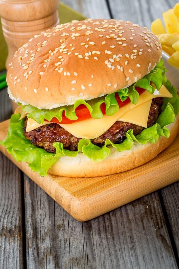 Burger. Tasty and appetizing hamburger cheeseburger royalty free stock images