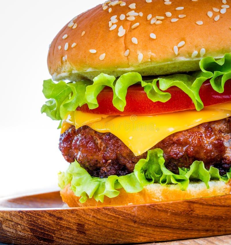 Burger. Tasty and appetizing hamburger cheeseburger royalty free stock photography